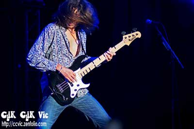 Photo of A.D.Zimmer on Bass, with Lou Gramm in concert at the CNE Bandshell. Photo credit ccvic.zenfolio.com