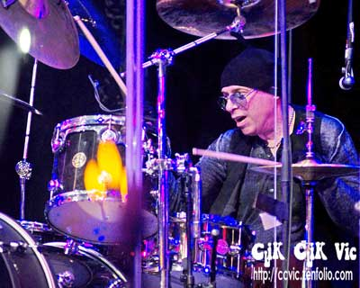Photo of Ben Gramm on Drums, with Lou Gramm in concert at the CNE Bandshell. Photo credit ccvic.zenfolio.com