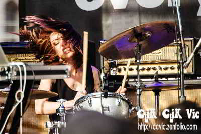 Photo of Jessica Goodwin, one of Big Black Delta's two Drummers, performing at NXNE 2013. Photo credit ccvic.zenfolio.com