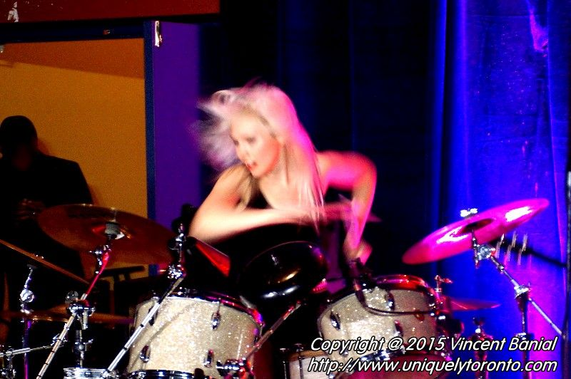"Photo of Renée Couture playing the drums in the band "" The StandStills"". Photo credit Vincent Banial"