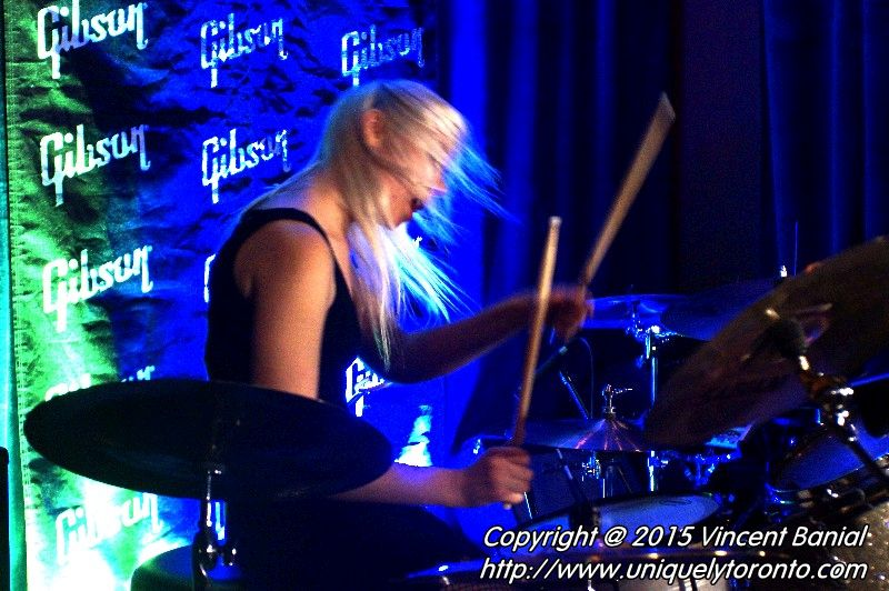 "Photo of Renée Couture playing the drums in the band ""The StandStills"". Photo credit Vincent Banial"