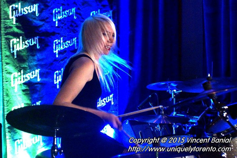 "Photo of Renée Couture playing drums in the band ""The StandStills"". Photo credit Vincent Banial"