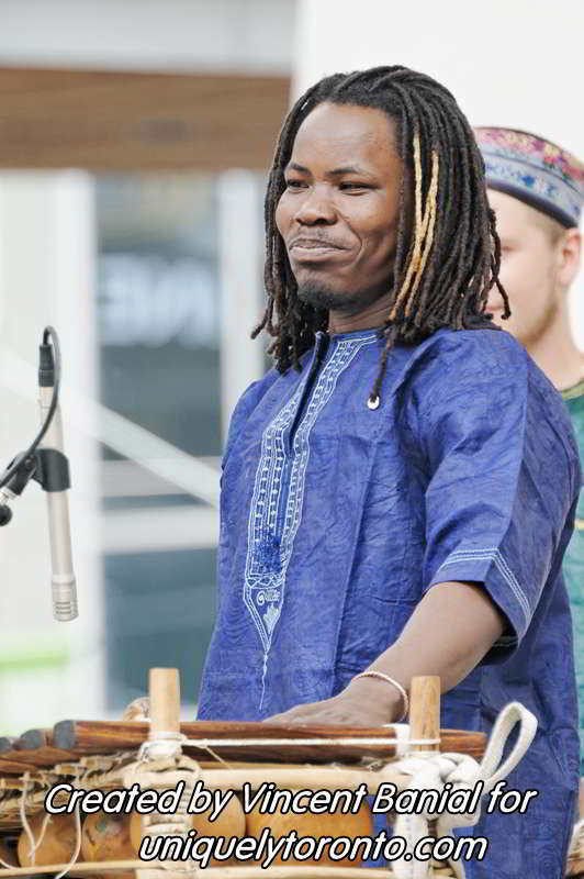 Photo of Katenan Dioubate - CHEKA performing at Yonge Dundas Square in Toronto on May 25 2015. Photo credit Vincent Banial