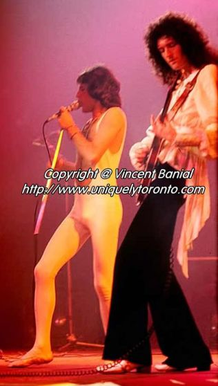 Photo of Freddie Mercury & Brian May of QUEEN performing in Toronto. Photo credit Vincent Banial