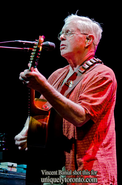 Photo of Bruce Cockburn performing on the WestJet Stage at Harbourfront Centre in Toronto, on July 21 2015. Photo credit Vincent Banial
