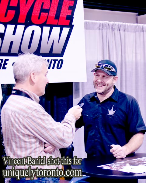 Photo of Paul Teutul Jr., of Paul Jr. Deigns, being interviewed at the North American International Motorcycle Supershow. Photo credit Vincent Banial